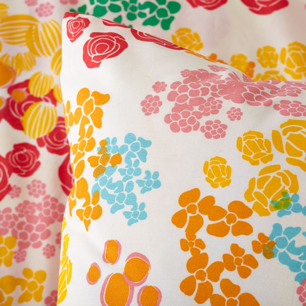 This is a super cute duvet with the colors popping against the white. www.designertrapped.com